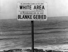 What is a policy or system of segregation or discrimination on grounds of race called?