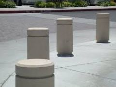 A permanent or retractable post to control traffic and protect property
