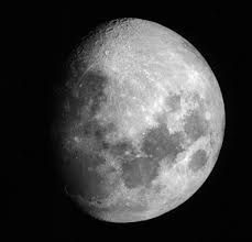 Convex at both edges, as the moon when more than half full.