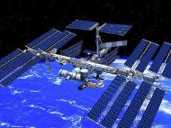 The International Space Station is a large spacecraft. It orbits around Earth. It is a home where astronauts live.