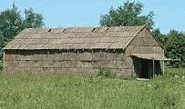 the traditional dwelling of the Iroquois and other North American Indians