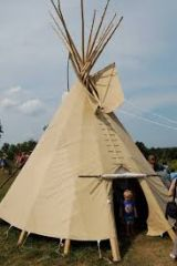 a portable conical tent made of skins, cloth, or canvas on a frame of poles, used by American Indians