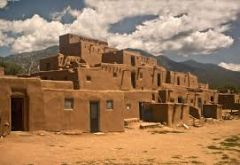 an American Indian settlement, especially one consisting of multistoried adobe houses built by the Pueblo people