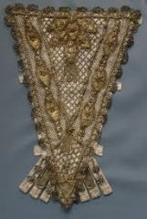 a decorated triangular panel that fills in the front opening of a woman's gown or bodice; may be boned, as part of a corset, or may cover the triangular front of a corset