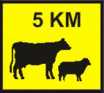 You hold an unrestricted licence and are driving at 100 km/h in the country and pass this sign. What should you do?