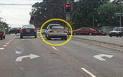 You are turning right from one of two right turn only lanes. How should you use your indicators?