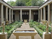 In Greek architecture, a surrounding colonnade. A peristyle building is surrounded on the exterior by a colonnade. A peristyle court is an open colonnaded courtyard, often having a pool or garden.