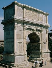 a heavy, rough building material made from a mixture of broken stone or gravel, sand, cement, and water, that can be spread or poured into molds and that forms a stonelike mass on hardening. Arch of Titus from Roman period was made of concrete.