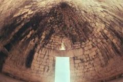 """Tholos Tombs """"Treasure of Atreus""""   Proto Greek / Mycenaean   1,250 B.C.E.   _______________________   Content: These were earth covered tombs that included large domes that were underground, but from above, could be seen as a hill. They..."""
